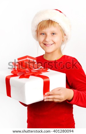 Child holding Christmas gift box in hand. Isolated on white background - stock photo