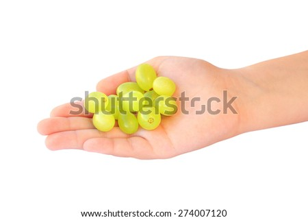 Child holding handful of grapes - stock photo