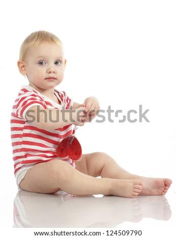 Child holding heart shaped candy isolated studio shot - stock photo