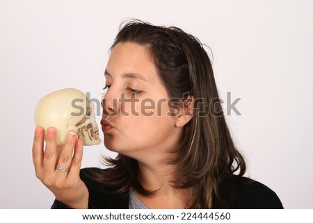 child holding skull - stock photo