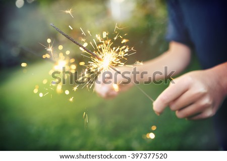 Child holding sparklers - stock photo