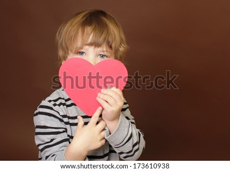 Child holding  Valentine's Day  Heart Sign - stock photo