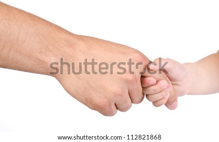 Child holds the finger of father isolated