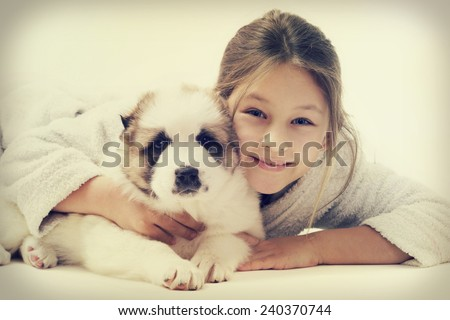 child hugging a puppy - stock photo