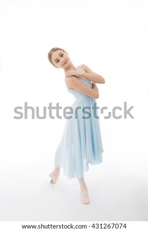 Child in a blue dress  is dancing on a white background - stock photo