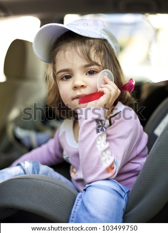 Child in a car seat - stock photo