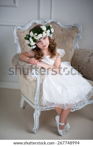 Child in a flower wreath