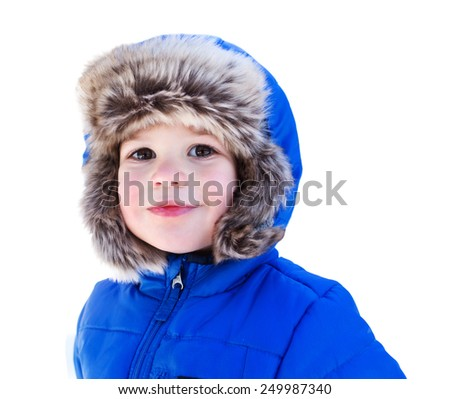 Child in a fuzzy fur snow hat and a winter jacket, face portrait, isolated over white