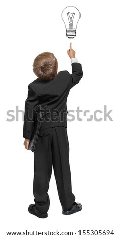 Child  in a tuxedo pointing at wall. Rear view. Isolated over white .  - stock photo