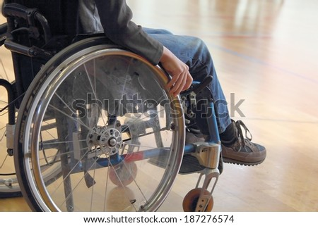 Child in a wheelchair - stock photo