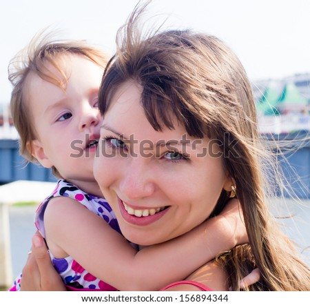 Child in arms of his mother