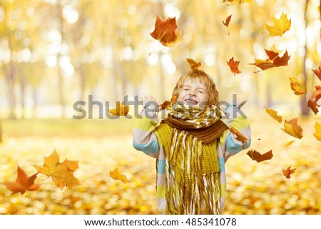 Child In Autumn Park, Little Kid Happy Playing Falling Leaves, fashion outdoor portrait