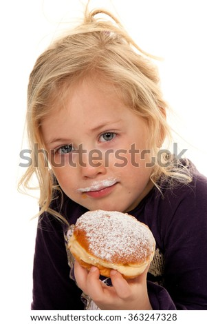 child in carnival with donuts. faschingskrapfen - stock photo