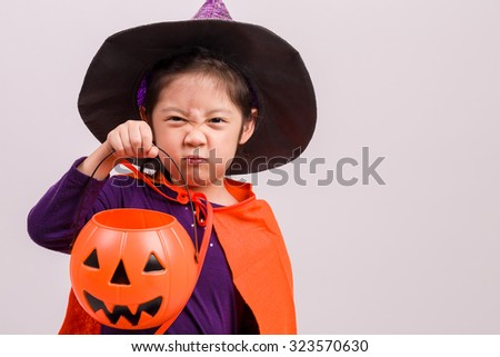 Child in Halloween Costume on White / Child in Halloween Costume / Child in Halloween Costume, Studio Shot - stock photo