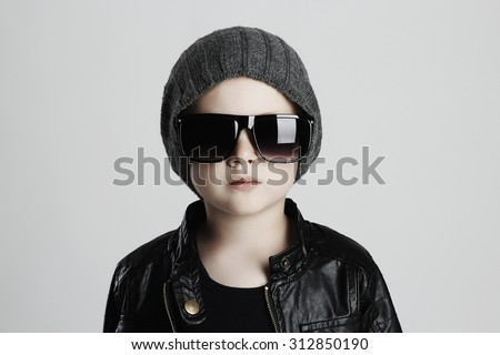 child in hat and glasses.fashionable little boy in sunglasses. winter fashion trendy kids - stock photo