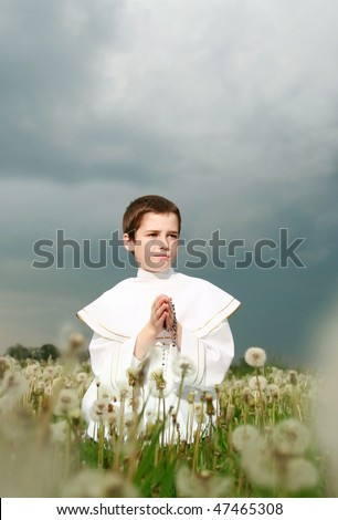 child in his first holy communion, praying hands, purity soul