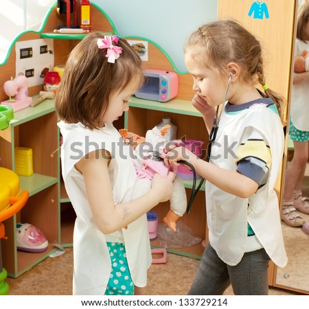 Child in kindergarten. Kids in nursery school. Girl playing at infant school