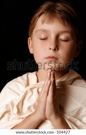 Child in prayer - stock photo