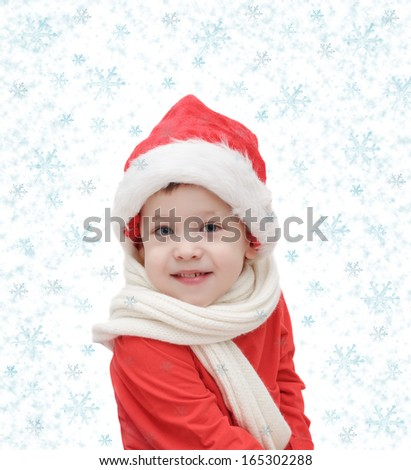 child in Santa Claus and snowflakes