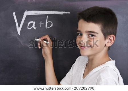 child in school blackboard with mathematical formula