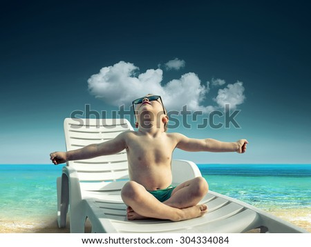 Child in sunglasses fun near the water under sunlight - stock photo