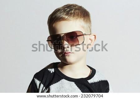 child in sunglasses.sad Little boy.Kids fashion - stock photo