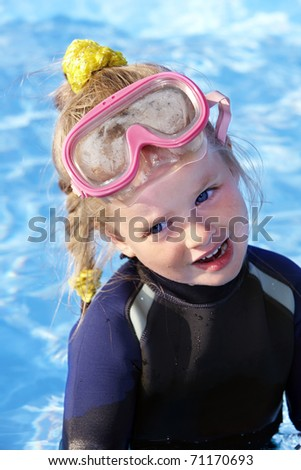Child in swimming pool learning snorkeling. Sport. - stock photo
