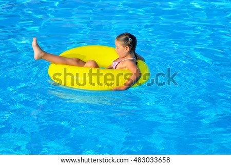 Child in swimming pool, vacation concept