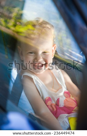Child in the car in his baby chair. - stock photo