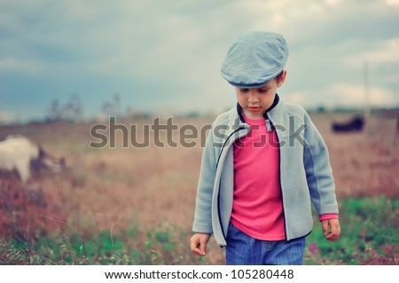 child in the field - stock photo