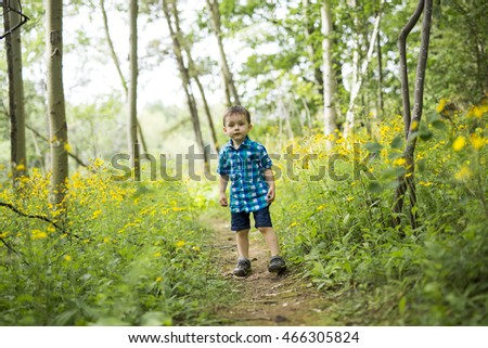 child in the forest having fun