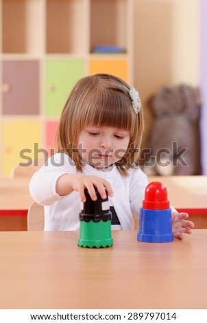 Child in the nursery draws