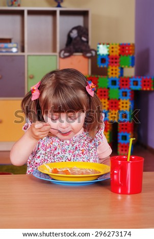 Child in the nursery eats soup