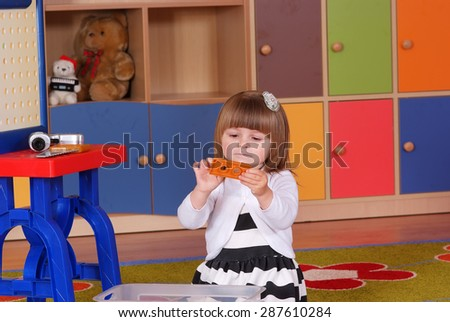 Child in the nursery is building