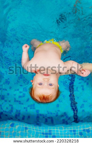 child in the pool. swimming for infants, disease prevention - stock photo