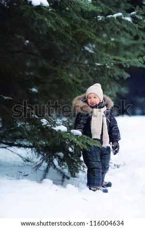 child in the woods, lots of snow - stock photo