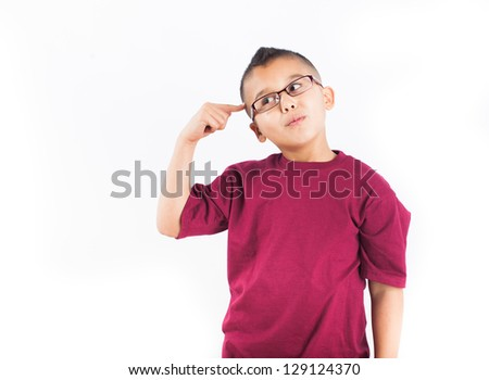 Child in thought Isolated on white background. Boy wearing glasses with a big Idea - stock photo