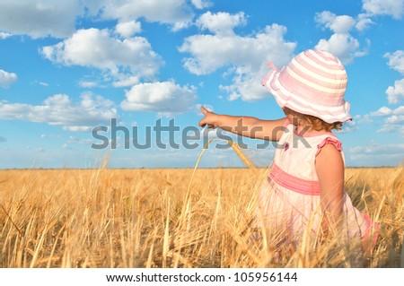 Child in wheat field - stock photo