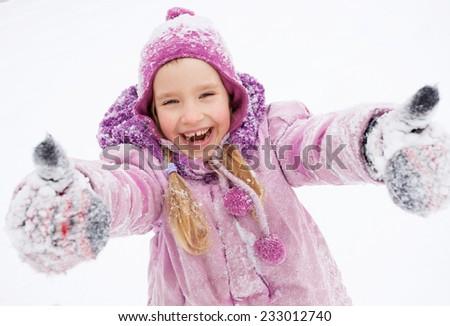 Child in winter. Happy girl on snow - stock photo