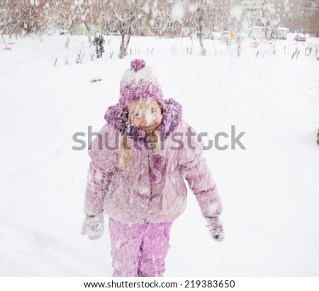 Child in winter. Happy girl on snow. Snowfall - stock photo
