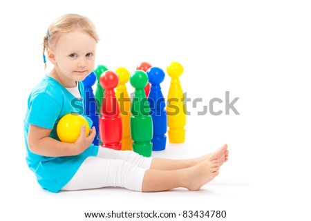 Child is bowling in studio