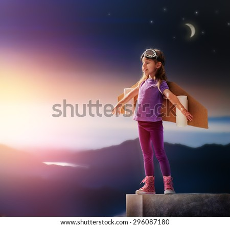 child is dressed in an astronaut costume - stock photo