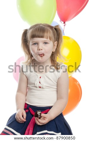 child is eating a cup cake