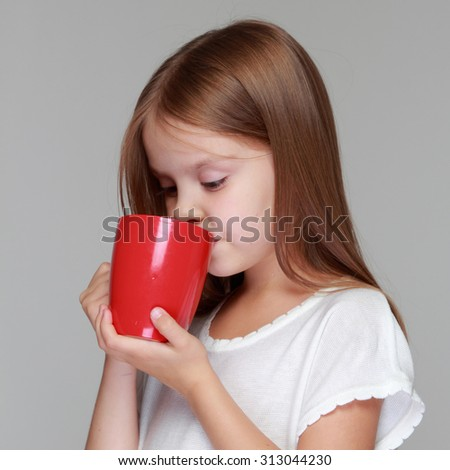 Child is ill with cup - stock photo
