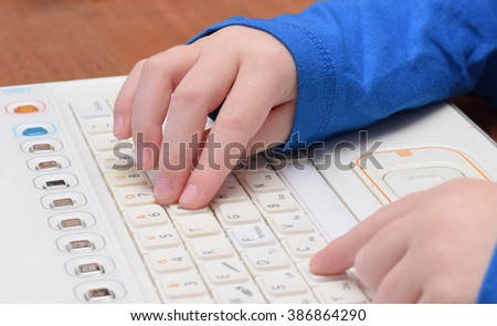 Child is learning computer