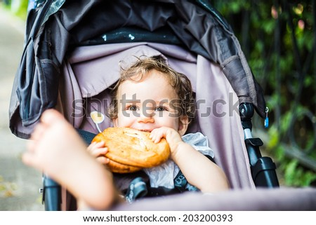 child is sitting in a wheelchair and eats
