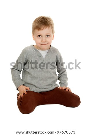 child is sitting in the studio on a white background