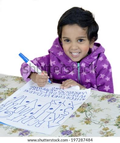 Child is writing alphabet - stock photo