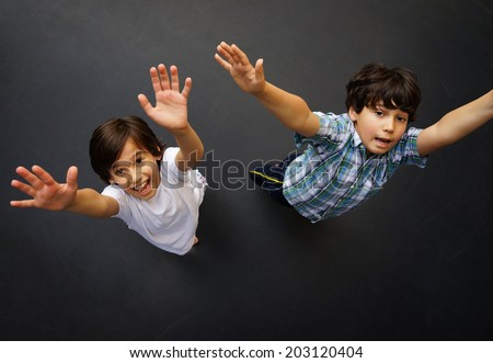 Child jumping on trampoline, high angle - stock photo