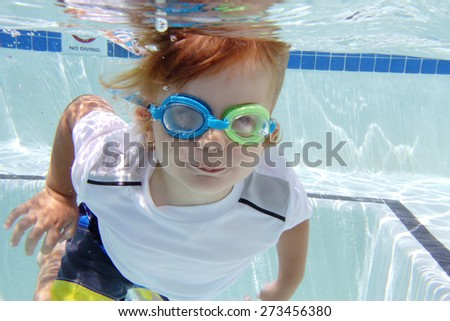Child, kid, diving or swimming in pool underwater, summer or sports theme